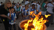 IMPERIAL — While sitting together in a circle, singing songs and watching a fire, the Girl Scouts in the Imperial Valley celebrated their 100 years of the organization.