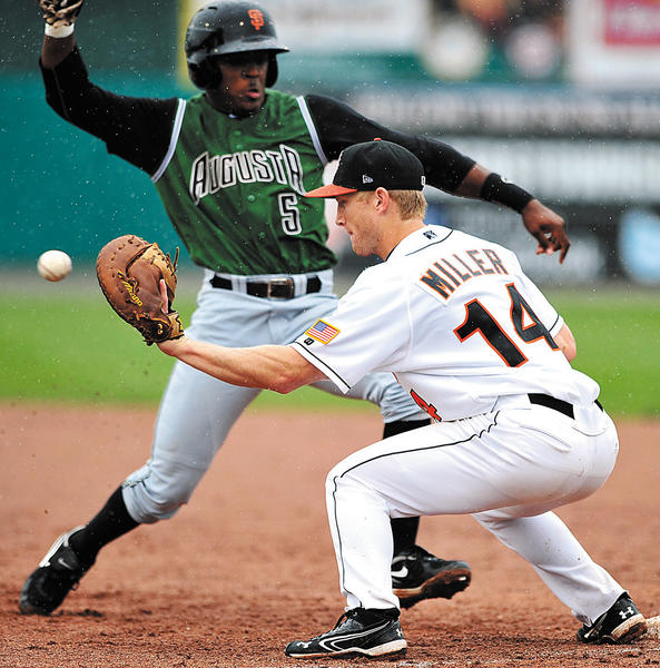 Augusta's Shawn Payne (5) gets back to first base while Hagerstown first baseman Justin Miller waits for a pickoff throw on Tuesday during the Suns' 8-1 loss.