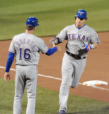 Josh Hamilton is greeted by Rangers third base coach after his fourth homer of the game, this one against Orioles reliever Darren O'Day.