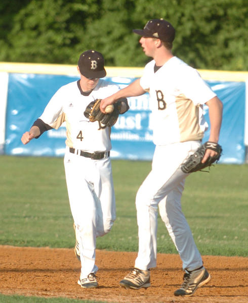 Boyle County pitcher Casey Whittle, right, celebrates with second baseman Brett Jones after they teamed up for the final out in the Rebels' 8-2 victory over Anderson County on Tuesday.  Whittle pitched a complete game, allowing two hits.