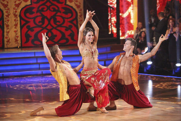 "L-R: Derek Hough, Maria Menounos and Henry Byalikov perform on ""Dancing with the Stars."""