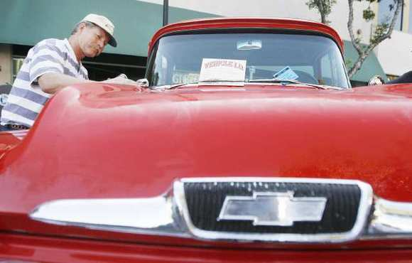 Mike Swenson polishes his 1958 Chevrolet pick up truck during Cruise Night, which took place along Brand Boulevard in Glendale last year.