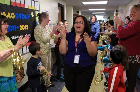 Maria Barba was surprised Wednesday with the Golden Apple Award at her Hoffman Estates school.