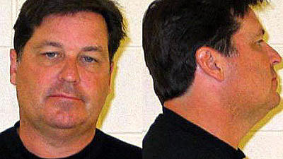 Mark E. Ditka in a 2011 booking mug for a previous arrest.
