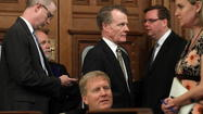 Madigan, Cross push retiree health premiums.