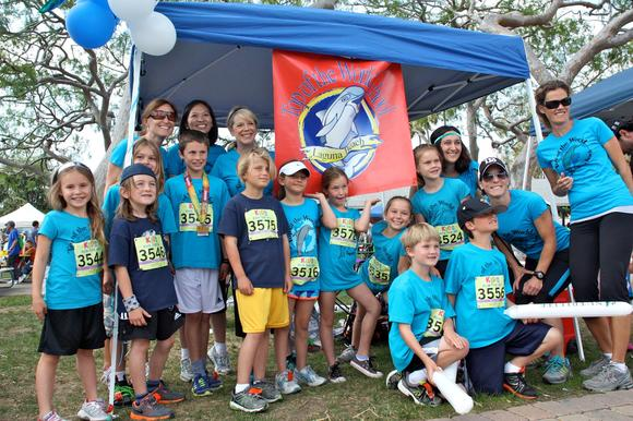 Students from Top of the World Elementary participate in the mile-long Kids Run at the OC Marathon as part of a 12-week fitness training program.