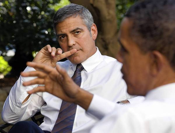 President Barack Obama talks with actor George Clooney outside the Oval Office in 2010.