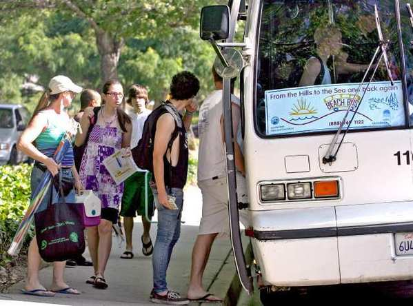 Local residents board the La Crescenta/La Canada Flintridge Beach Bus to start the Summer's first run at Two-Strike Park in La Crescenta in 2010. The service will return this summer.