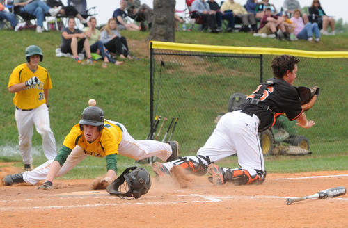 North Harford's Ryan Stinar slides safely into home against Rising Sun.