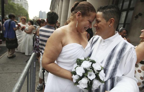 In New York, Maira Garcia, right, and Maria Vargas wait in line to get married at the Brooklyn City Clerks office last year.