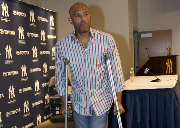 Mariano Rivera leaves a news conference.