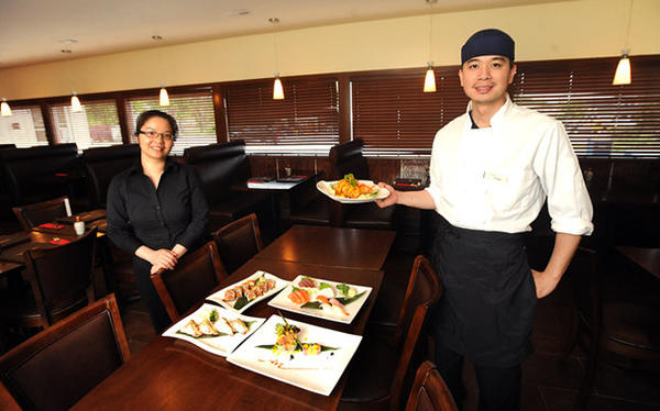 Donny Chen right, along with his wife Anna Chen left, owners of D M Sushi Japanese Restaurant in Palmer Township.