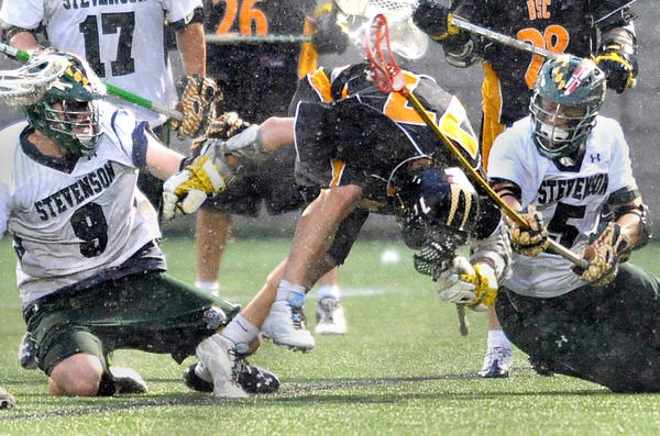 Stevenson's Kyle Holechek (9) and Parker Bratton hit Birmingham Southern's Erik Klein on his way to the ground after a second-quarter scrum for the ball.