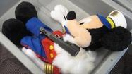 A man traveling with his 4-year-old son claims he didn't know that the three stuffed animals his little boy put on a conveyor belt at T. F. Green International Airport in Warwick, Rhode Island, contained parts that could be assembled into a loaded handgun, the Transportation Security Administration says.