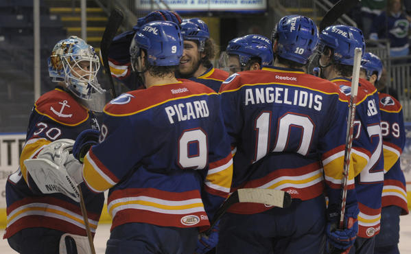 The Norfolk Admirals congratulate their goalie Jaroslav Janus after he didn't allow a goal in their win. The Connecticut Whale lost to the Norfolk Admirals in game five of the second-round of the Calder Cup playoff series at the Webster Bank Arena in Bridgeport by a score of 4 to 0, to fall behind in the series two games to three.
