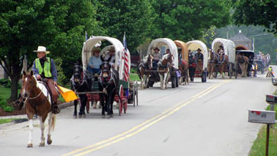 Covered wagons arrive at last year's National Road Festival in Addison.