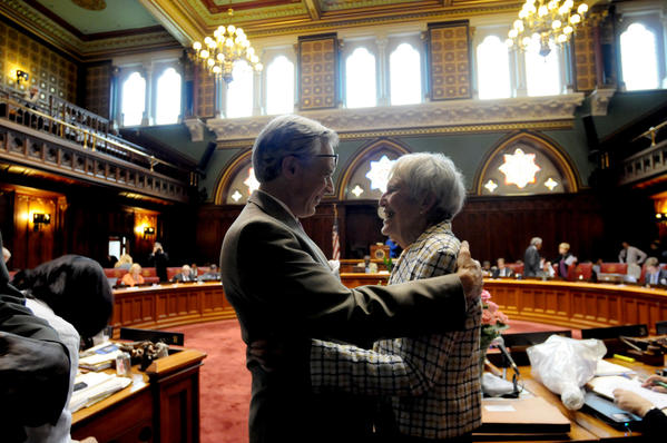 Retiring Sen. Edith Prague, right, is greeted by Rep. Peter Tercyak, who served as her campaign manager when she ran for the Senate 18 years ago. Prague was honored in the Senate chambers by her colleagues Wednesday, the closing day of the legislative session.