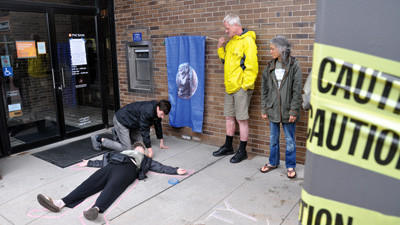 About 10 members of the Earth Quaker Action Team protested in front of the PNC Bank in Somerset Wednesday.