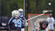 Loyola's Josh Hawkins (5), Johns Hopkins' Chris Lightner