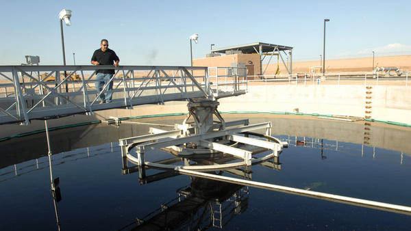 Ruben Mireles, operations divisions manager, shows a clarifier unit at Brawley's Wastewater Treatment Plant on Wednesday.