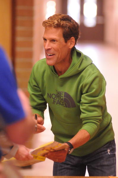 Ultra-marathon runner Dean Karnazes signs autographs to fans following his speech at the Petoskey Middle School auditorium Wednesday.