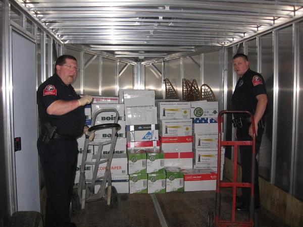 Petoskey Department of Public Safety officers Randy Davis (left) and Karl Fritz (right) transport 780 pounds of pharmaceuticals collected from the permanent drop-boxes located at law enforcement offices around Northern Michigan.
