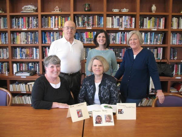 Members of the Friendship Centers' Grandparents Raising Grandchildren support group go over some of the parenting education materials they will be using this summer, thanks to a grant from the Petoskey-Harbor Springs Area Community Foundation. Members include (front, from left) Barb Couture, Joanne Deckinga; (back) Bill Couture; Sara Ward, community foundation program officer; and Sue Ann Bouwense, support group coordinator.