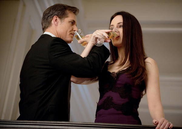 Henry Czerny and Madeleine Stowe toast to 2002.