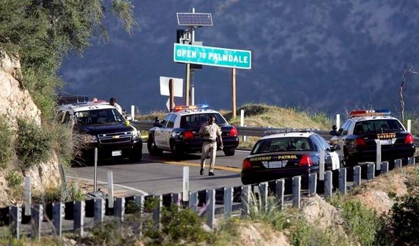 Authorities closed the Angeles Crest Highway Thursday morning after a body was found on or near the roadway.