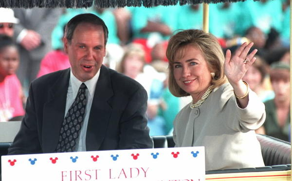First Lady Hillary Clinton and Disney chairman Michael Eisner ride in a parade before the rededication ceremony tied to Disney World's 25th anniversary.