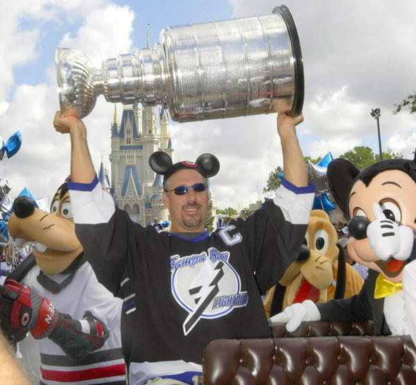 The big prize of the National Hockey League was paraded down Main Street after the Tampa Bay Lightning won the championship in 2004. It's hoisted by team captain Dave Andreychuk.