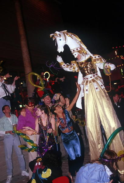 Once upon a time, Disney's Pleasure Island threw a Mardi Gras parade with stilt walker, beads and more.