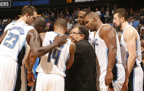Orlando head coach Stan Van Gundy draws up the play during a timeout in overtime of the Magic's 89-87 loss to the Atlanta Hawks in Orlando, Fla. Friday, February 10,  2012.