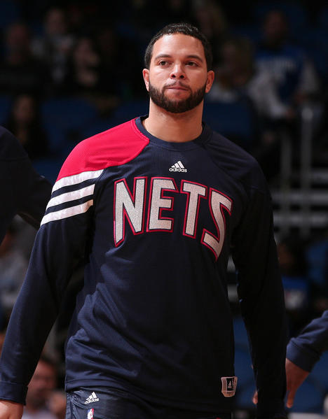 New Jersey's Deron Williams warms up for the Nets' game against the Orlando Magic at Amway Center in Orlando, Fla. Friday, December 29, 2011.