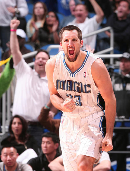 Orlando forward Ryan Anderson (33) celebrates after hitting a three-pointer late in the fourth quarter of the Magic's come from behind 102-96 victory over the Toronto Raptors at Amway Center in Orlando, Fla. Sunday, January 1, 2012.