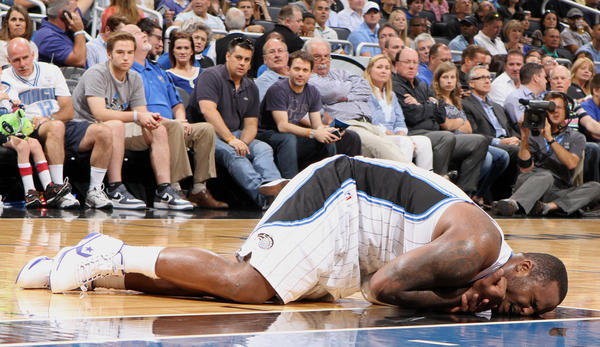 Orlando center Glen Davis (11) goes down with an injury during the first half of the Magic's game against the Charlotte Bobcats in Orlando, Fla. Wednesday, April 25, 2012.  Davis left the game following the injury.