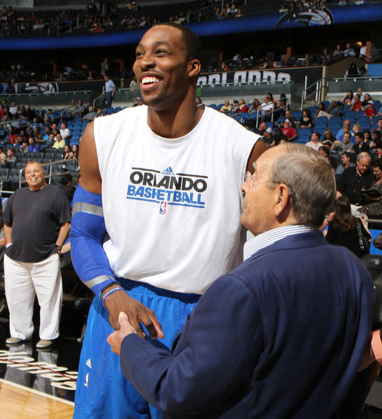 Orlando Magic center Dwight Howard talks with Magic owner Rich DeVos before their game against the New Jersey Nets in Orlando, Fla. Friday, March 16, 2012.