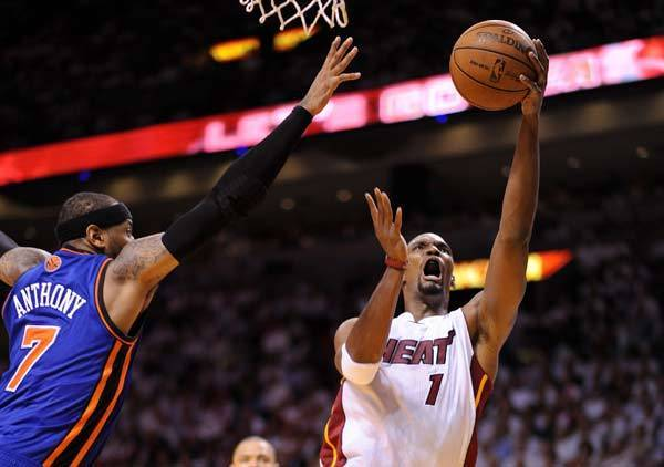 Miami Heat power forward Chris Bosh (1) drives to the basket as New York Knicks small forward Carmelo Anthony (7) defends during the second half of game five in the Eastern Conference quarterfinals of the 2012 NBA Playoffs at the American Airlines Arena.