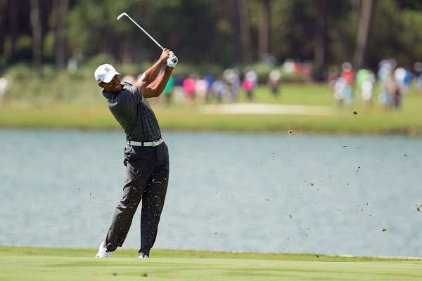 Tiger Woods plays his approach shot to the 18th during the first round of the Players Championship at TPC Sawgrass.