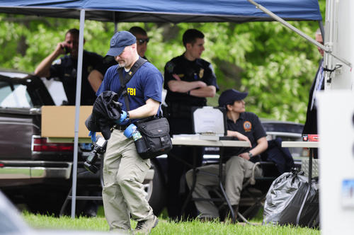 Federal and local law enforcement authorities search the Manchester, Ct, house of Robert Gentile. Photograph by MARK MIRKO | mmirko@courant.com