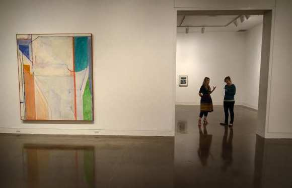 "Sarah C. Bancroft, left, curator for ""Richard Diebenkorn: The Ocean Park Series,"" talks about the soon-to-be opened exhibition at the Orange County Museum of Art in February."