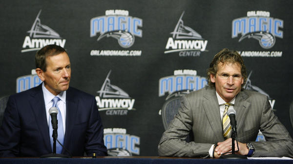 Orlando Magic's Bob Vander Weide, right,  announces he is stepping down as Chief Executive Officer, handing the reins over to Alex Martins,  during a press conference at Amway Arena, Wednesday, December 7, 2011.  Dan DeVos, left, will take over as Chairman of the Orlando Magic.