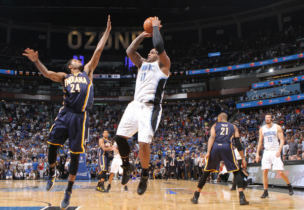 The Orlando Magic's Glen Davis (11) shoots over Indiana Pacers Paul George (24) for the final shot to tie the game, during Game 4 of the NBA Eastern Conference playoffs at the Amway Center in Orlando, Florida, Saturday, May 5, 2012. The Pacers defeated the Magic in overtime, 101-99.
