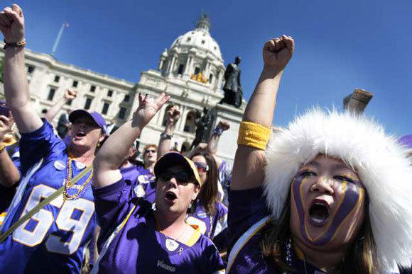 Vikings fans gather outside of the state Capitol in St. Paul, Minn., to show their support for a new stadium.