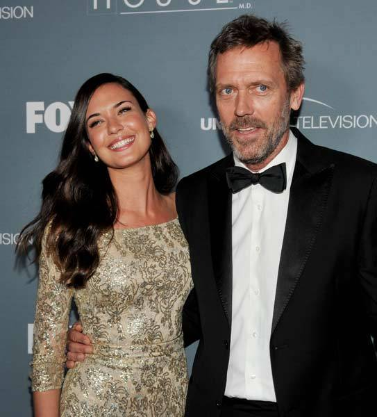 Actors Odette Annable (L) and Hugh Laurie arrive at Fox's 'House' series finale wrap party at Cicada on April 20, 2012 in Los Angeles, Calif.