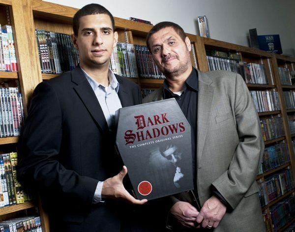 "Executive VP Hamza Ali and CEO Malik Ali inside of the store room at the company headquarters of MPI Media Group in Orland Park. MPI optioned the rights to distribute the television series ""Dark Shadows"" in it's entirety. The 131-DVD set includes every episode of the series and comes in a coffin-shaped case."