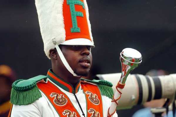 Robert Champion, a drum major in Florida A&M University's Marching 100 band, is shown performing in November. Eleven band members have been charged with felony hazing in connection with his death.