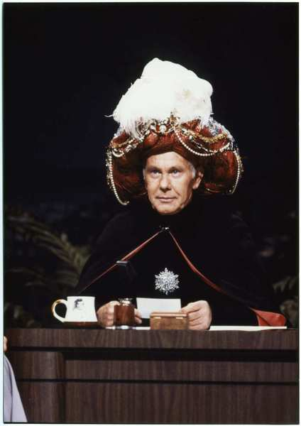 "Johnny Carson as the recurring character Carnac the Magnificent, a ""mystic from the east"" who knew the answers to unknown questions."