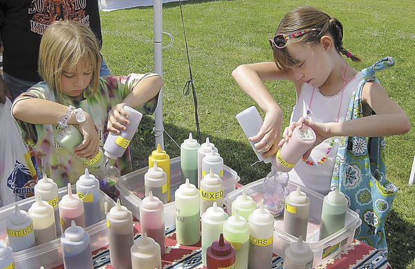 Ashlyn Jewell, left, and McKenzie Raidt make sand art at Mountaintop Heritage Days in this 2010 file photo. This years event is scheduled for Saturday, June 30, and Sunday, July 1.