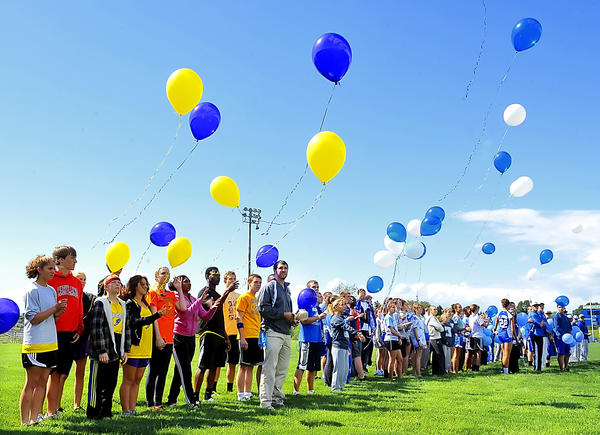 Students from several Washington County high schools release balloons at Williamsport High School Thursday in tribute to four of their classmates who passed away in recent months.